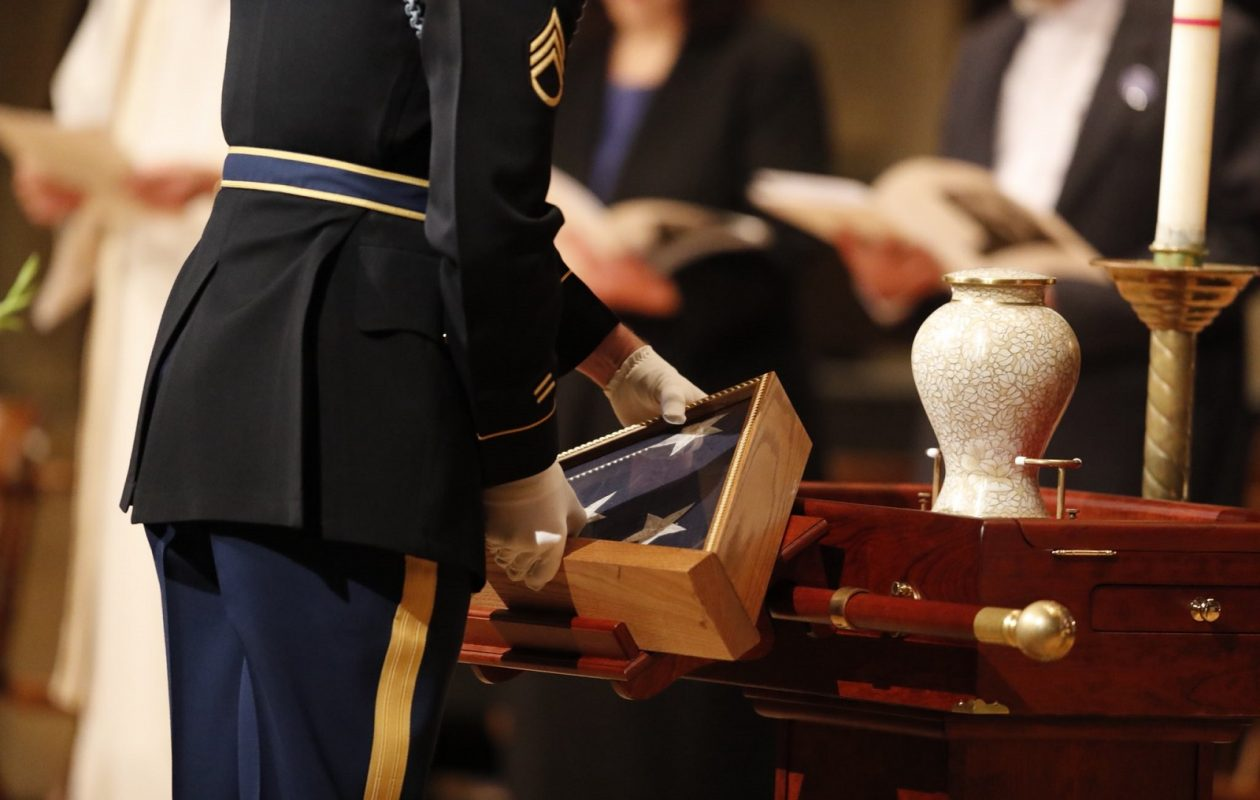 A folded flag is placed before the urn with the ashes of Rep Louise Slaughter during her funeral service in Rochester Friday. (Mark Mulville/Buffalo News)