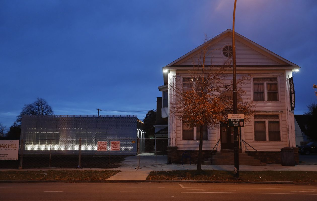 The new Torn Space Theater building to the left of Adam Mickiewicz Library and Dramatic Circle on Fillmore Avenue was designed to give off a shimmering appearance at night thanks to beams of light projected from below. (Mark Mulville/Buffalo News)