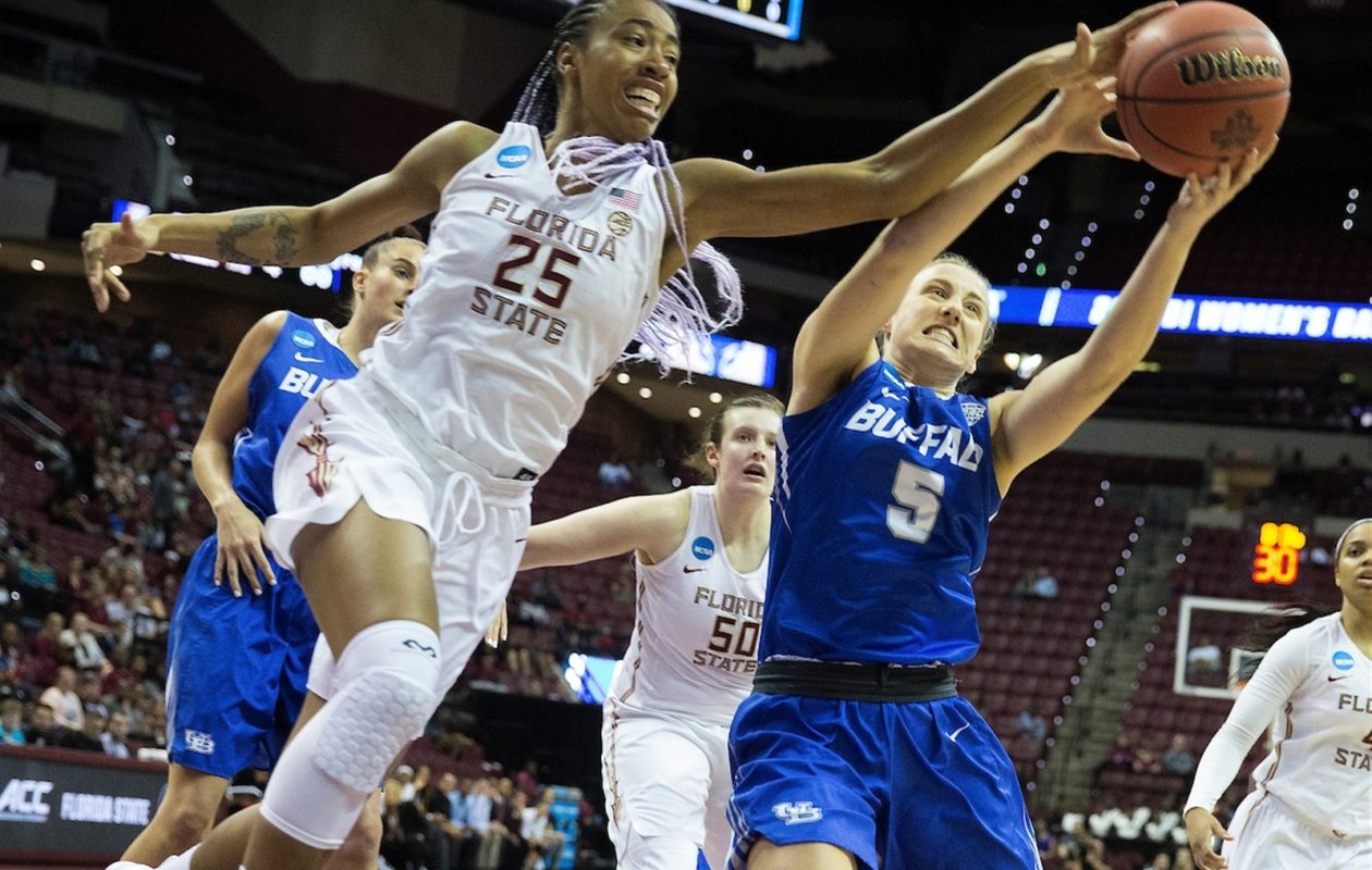 Florida State center Ama Degbeon (25) and Buffalo guard Katherine Ups battle for a rebound in the first half. Mark Wallheiser/University at Buffalo