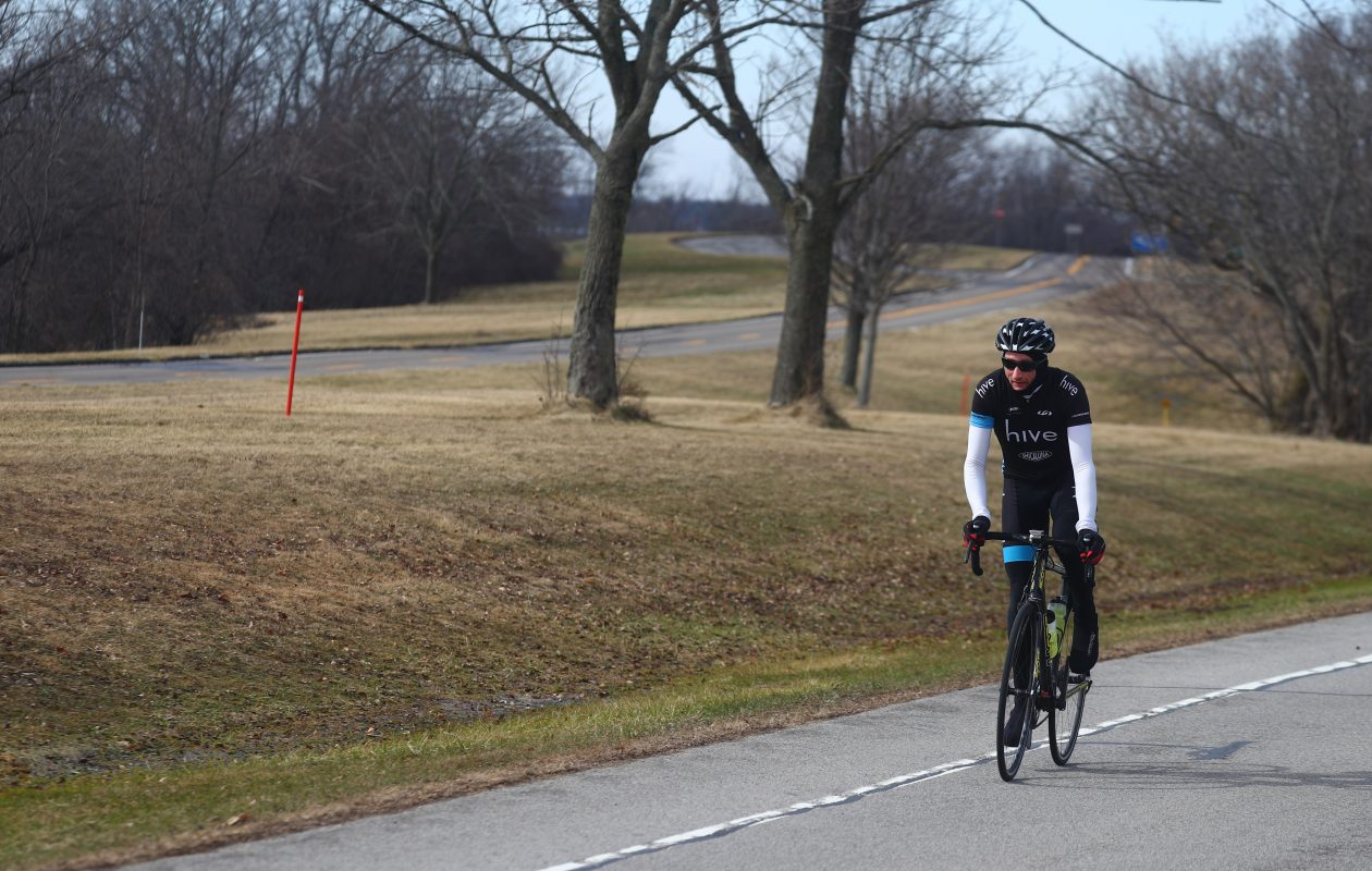A bicyclist on West River Road with West River Parkway in the background in Grand Island on Sunday, Feb. 25, 2018. (John Hickey/Buffalo News)