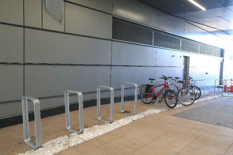 New racks that can hold 100 bikes outside the new University at Buffalo Medical School are part of a nearly threefold increase in the number of bike racks on the Buffalo Niagara Medical Campus. (John Hickey/Buffalo News)