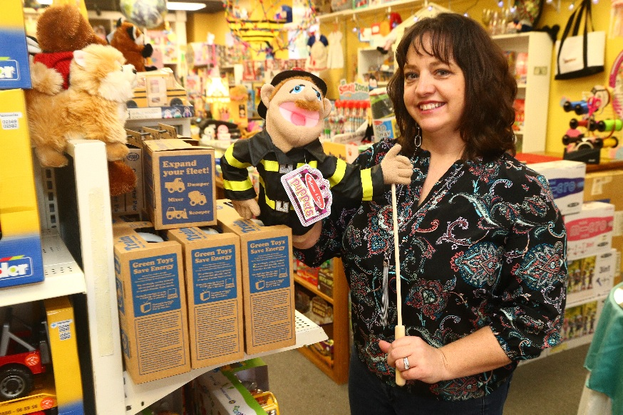 Crystal Newman, owner of Bloomsbury Lane Toy Shoppe, shows off her puppetry skills. (John Hickey/Buffalo News)