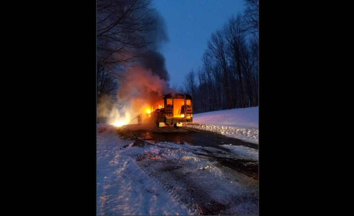 Three children and a bus driver safely escaped from this school bus which caught fire Friday morning in Machias in Cattaraugus County, State Police said. (New York State Police)