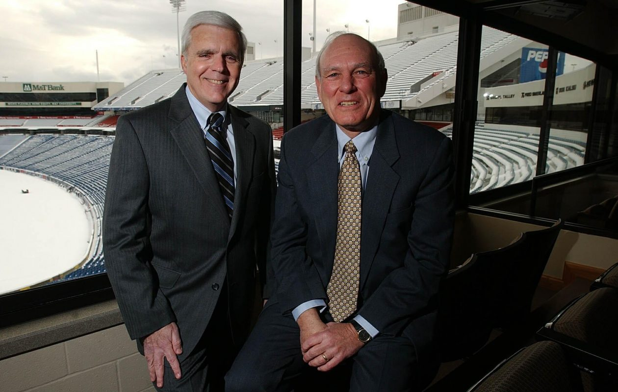 Erland 'Erkie' Kailbourne (right), shown with then-Bills GM Tom Donahoe, is exiting Five Star Bank's board. (News file photo)
