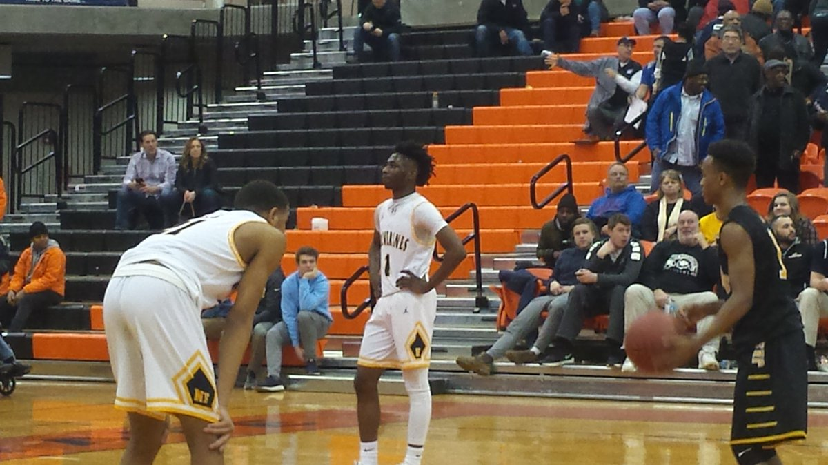 Niagara Falls senior Tazaun Rose watches McQuaid's Anthony Iglesia close out the Knights' Far West Regional win on Saturday night from the free-throw line at Buffalo State Sports Arena (Miguel Rodriguez)