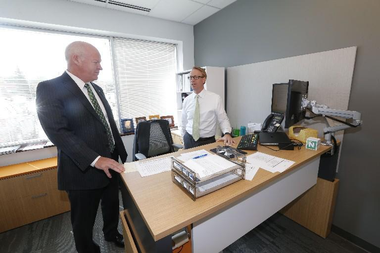 John Golding, left, is getting a promotion with Northwest Bank. (News file photo)