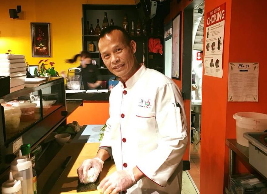 Owner Chanpheng Souvannaseng rolls sushi at his new restaurant, Pho 54. (Pho 54)