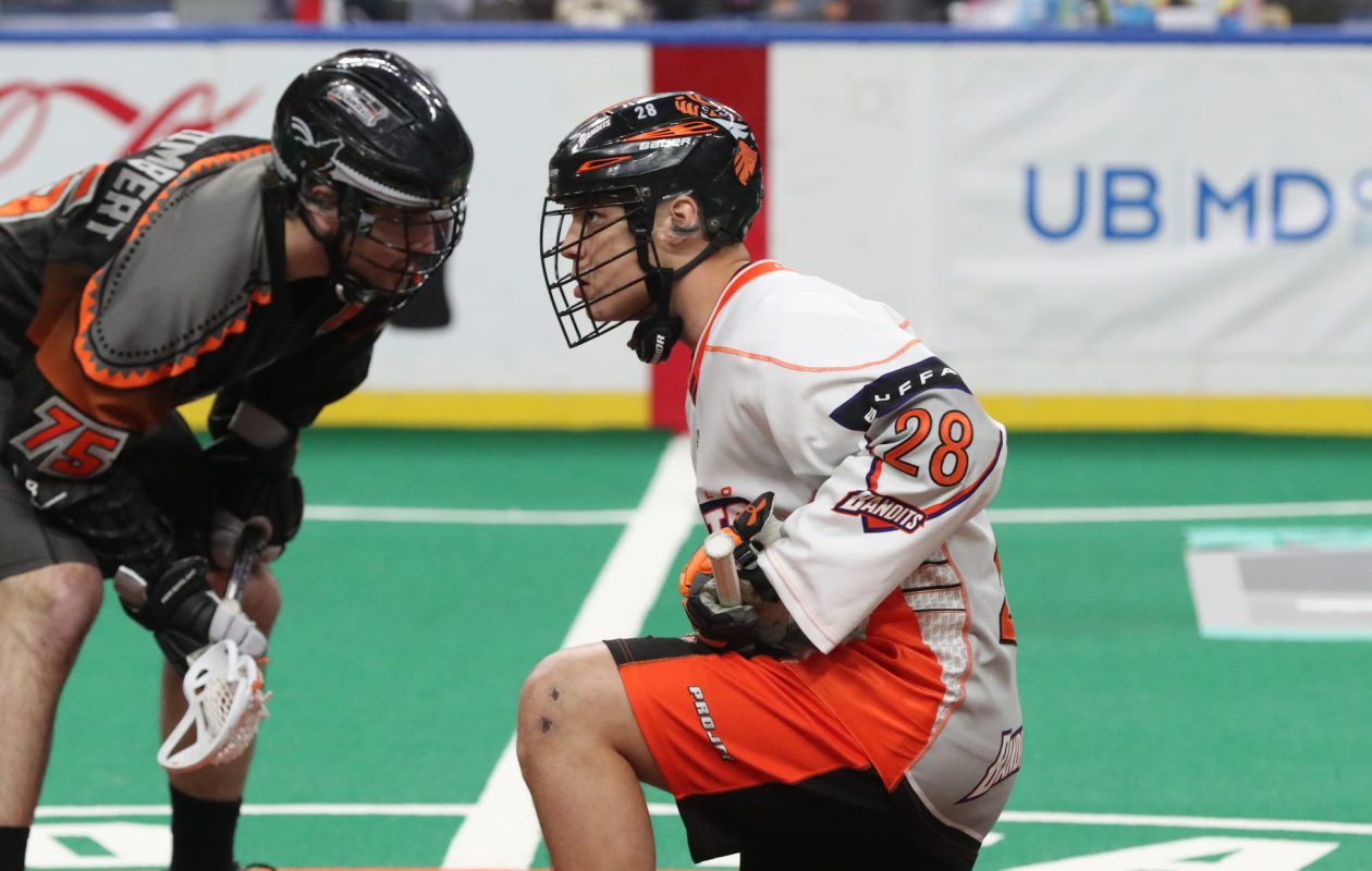 Bandits Vaughn Harris lines up against New England's Jay Thorimbert, for the face off in the first quarter at Key Bank Center in Buffalo N.Y. on Saturday, March 31, 2018.  (James P. McCoy/Buffalo News)