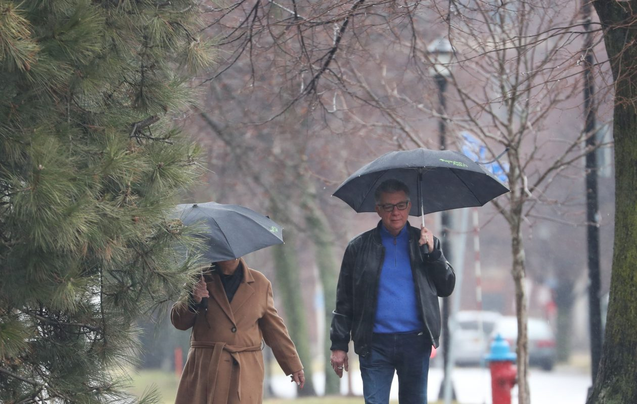 It was another day for umbrellas and winter coats in Buffalo on Monday. (Sharon Cantillon/News file photo)