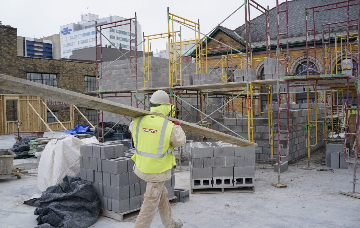 Masons construct the stairwells and elevator shafts at Nineteen North, a new 36-unit residential complex under construction on the edge of Allentown in the medical campus, Thursday, April 5, 2018. (Derek Gee/Buffalo News)