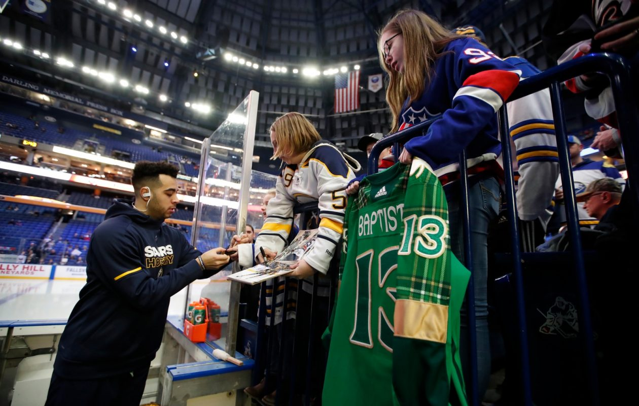 Nick Baptiste, signing autographs before Wednesday's home finale, says the Sabres need to trust the game plan. (Harry Scull Jr./Buffalo News)