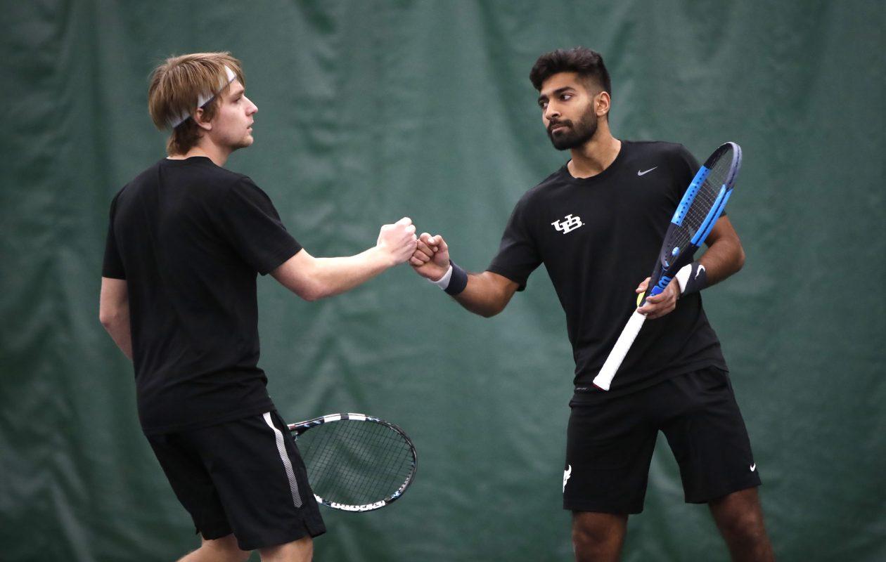 Petr Vodak and Vidit Vaghela play against Binghamton at the Miller Tennis Center on Friday April 6, 2018. (Harry Scull Jr./ Buffalo News)