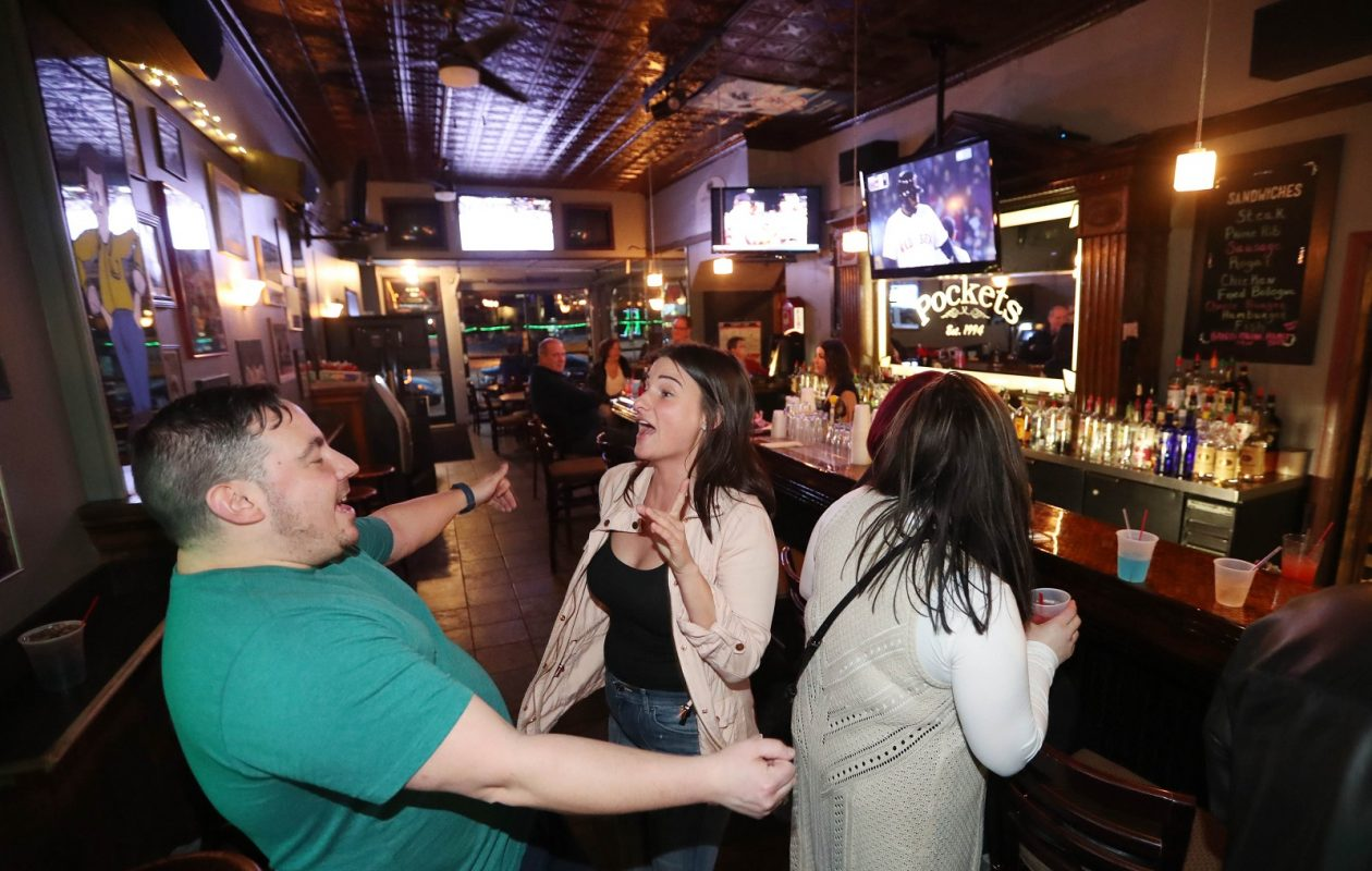 Mike Matters, left and Jamie Fanara of Buffalo dance to a song on M.T. Pockets' jukebox. (Sharon Cantillon/Buffalo News)