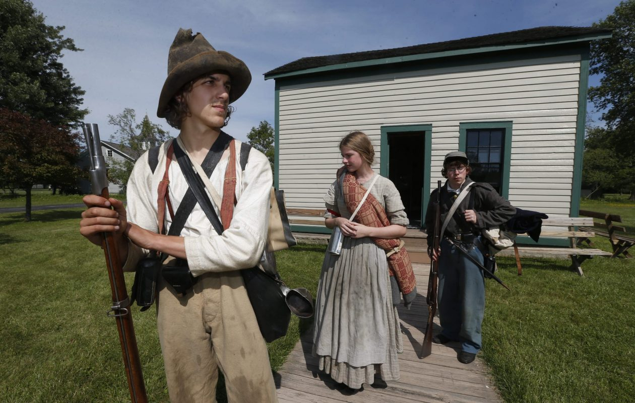 From left, Rebels Nathan Kalvitis, 19, Katie Gaisser, 18, both of Rochester, and Beau Hoover, 16, of Chili, represent members of the 34th North Carolina Infantry Civil War volunteers at Americana Days at the Buffalo Niagara Heritage Village in Amherst on Saturday, July 12, 2014.  (Robert Kirkham/Buffalo News)