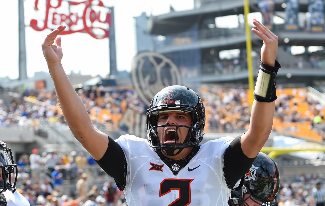 PITTSBURGH, PA - SEPTEMBER 16: Mason Rudolph #2 of the Oklahoma State Cowboys celebrates after a touchdown by Dillon Stoner #17 (not pictured) during the first quarter against the Pittsburgh Panthers at Heinz Field on September 16, 2017 in Pittsburgh, Pennsylvania. (Photo by Joe Sargent/Getty Images)