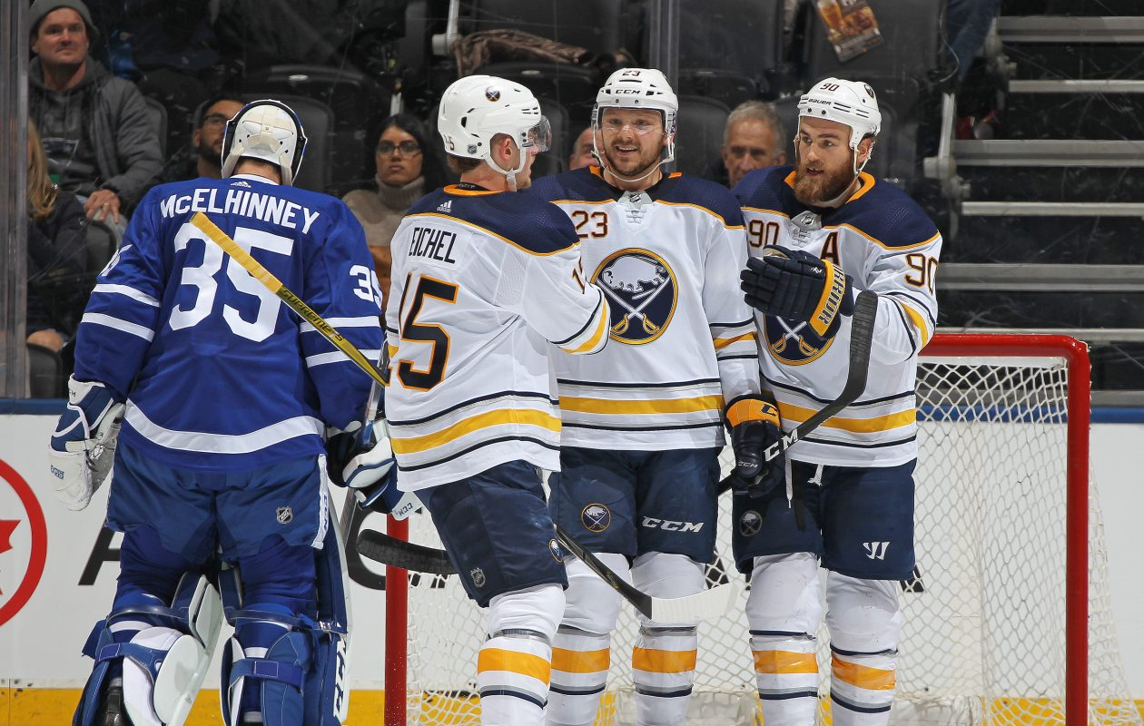 The Sabres' Jack Eichel and Ryan O'Reilly (90) congratulate Sam Reinhart after he tipped a shot past Toronto goalie Curtis McElhinney for his career-high 24th goal. (Getty Images)