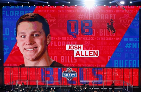 The Bills select quarterback Josh Allen  of the Wyoming Cowboys as the 7th pick after moving up from the 12th spot in the first round of the NFL Draft