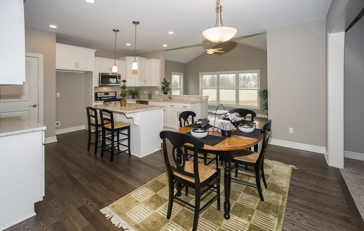 The home shows a dinette between the kitchen and greatroom, but the sunroom off the ktichen would work for informal dining as well.