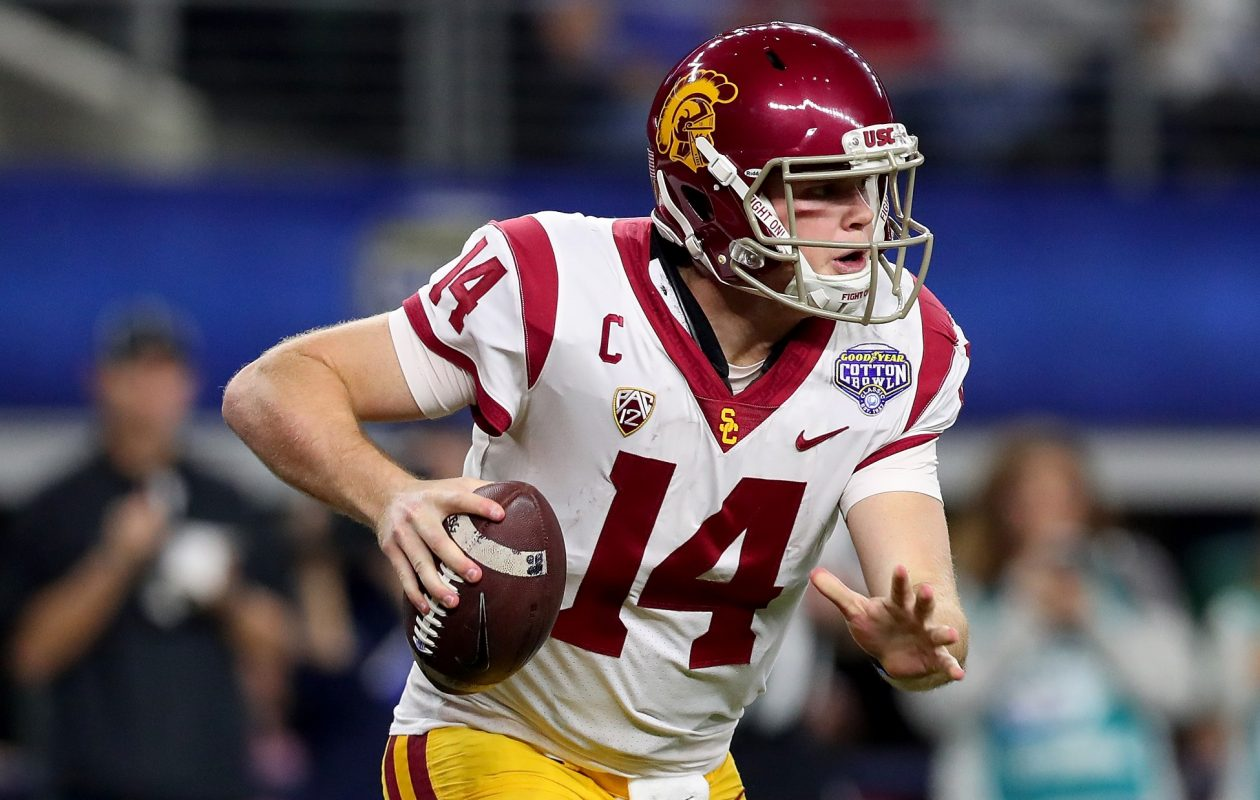 Sam Darnold of the USC Trojans looks for an open receiver against the Ohio State Buckeyes during the Goodyear Cotton Bowl Classic at AT&T Stadium on Dec. 29, 2017, in Arlington, Texas. (Tom Pennington/Getty Images)