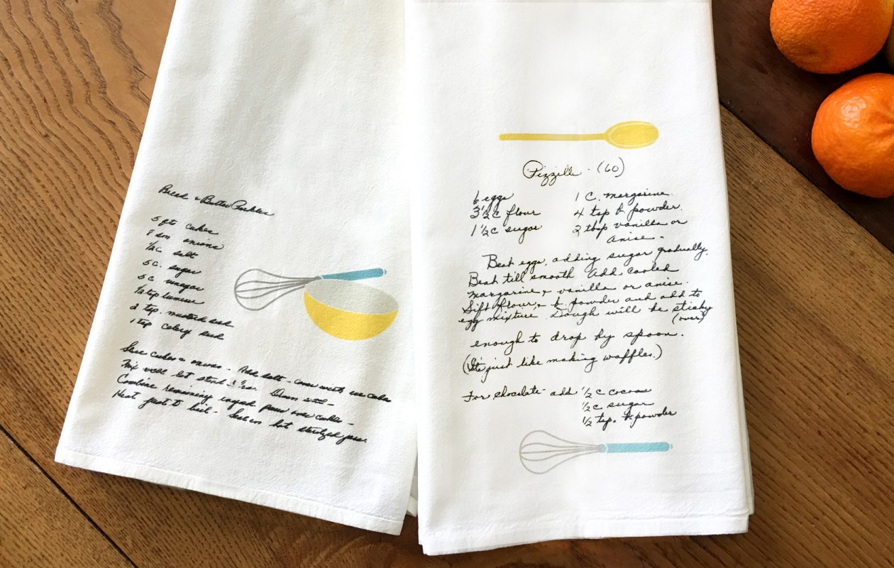 Custom tea towels by Inspired Buffalo capture family recipes.