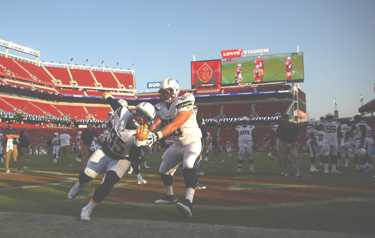 Tenny Palepoi #95 and Dan Feeney #66 of the Los Angeles Chargers warm up before their game against the San Francisco 49ers at Levi's Stadium on August 31, 2017 in Santa Clara, Calif. (Getty Images)
