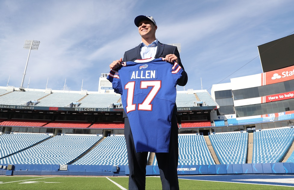 Buffalo Bills first round pick, quarterback Josh Allen, poses with his No. 17 jersey at New Era Field in Orchard Park Friday. (James P. McCoy/Buffalo News)