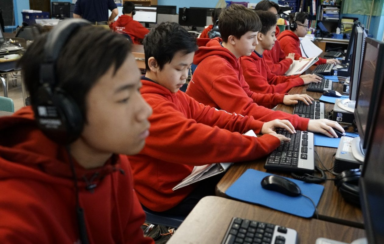 Eighth grade students work at computers in their writing innovations class at Our Lady of Black Rock School. (Derek Gee/Buffalo News)