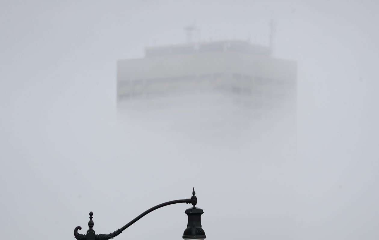 Seneca One Tower shrouded in fog forms a backdrop for a lamp post on Ohio Street earlier this year. Fog is expected to persist downtown into late morning, the National Weather Service reported. (Sharon Cantillon/News file photo)