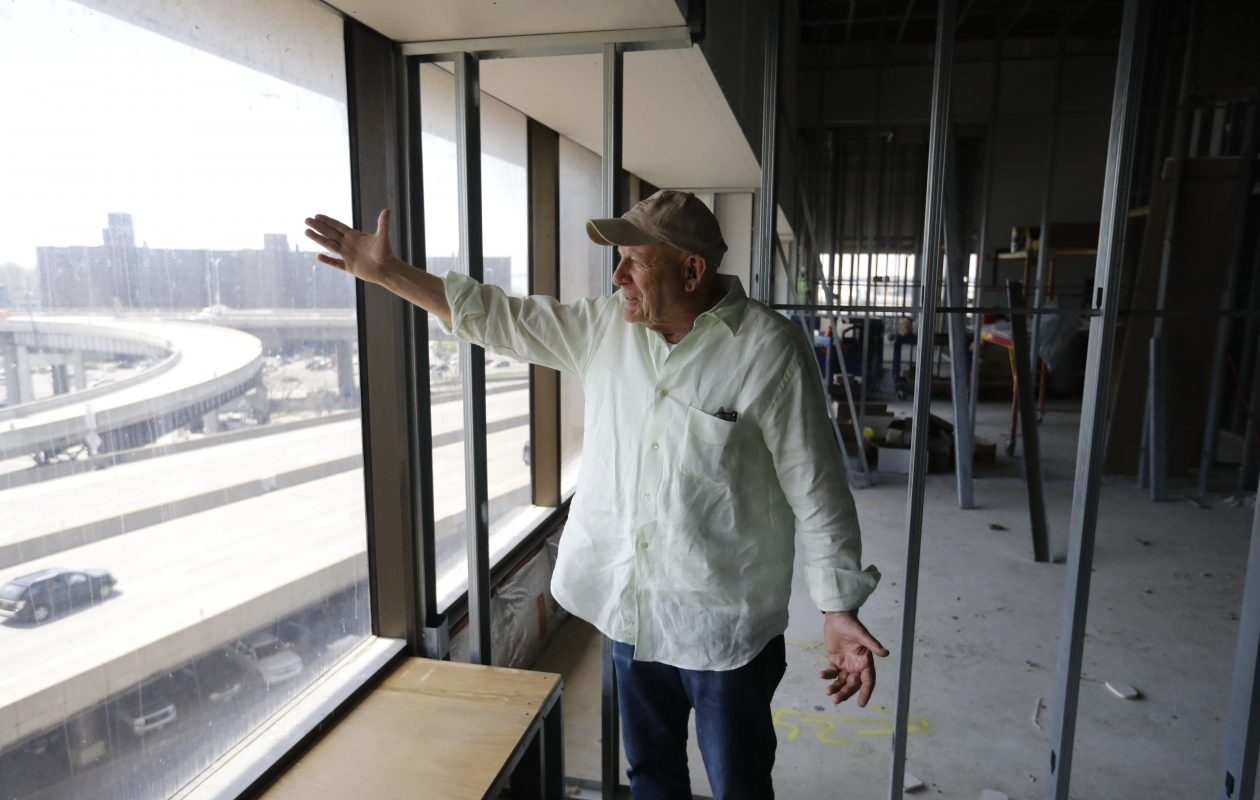 'We've been working inside all winter long doing what you're seeing now. It's not as if we've been standing still,' says One Seneca Tower owner Douglas Jemal, gesturing toward Canalside from inside the frame of an apartment. (Derek Gee/Buffalo News)
