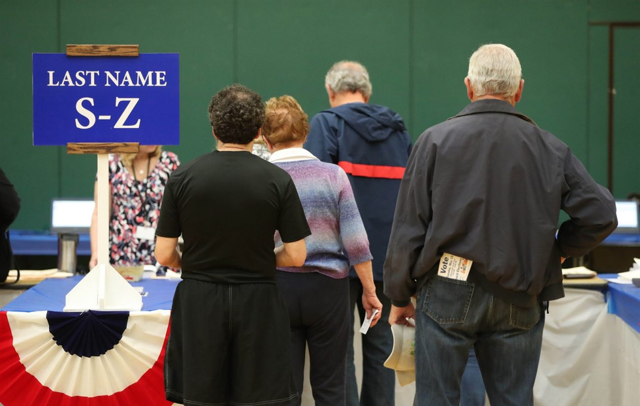 Williamsville North voters wait in line to sign in and get ballots. (Sharon Cantillon/Buffalo News)
