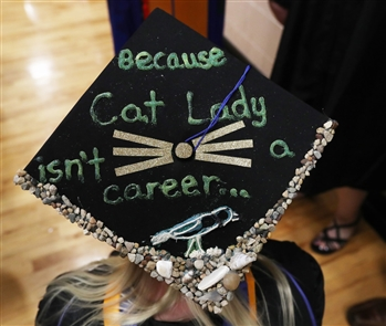 Creatively decorated mortarboards at Canisius College graduation in Buffalo express the hopes, dreams, celebration and humor of the Class of 2018  Saturday May 19, 2018.
