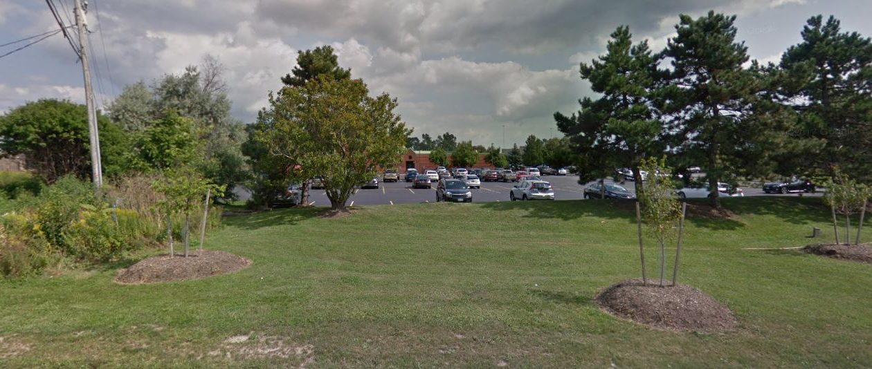 This image shows the property at 1185 Sweet Home Road where Landmark Properties of Georgia plans to build student housing. The now-shuttered Lifetime Health Clinic is in the background. (Google Image)