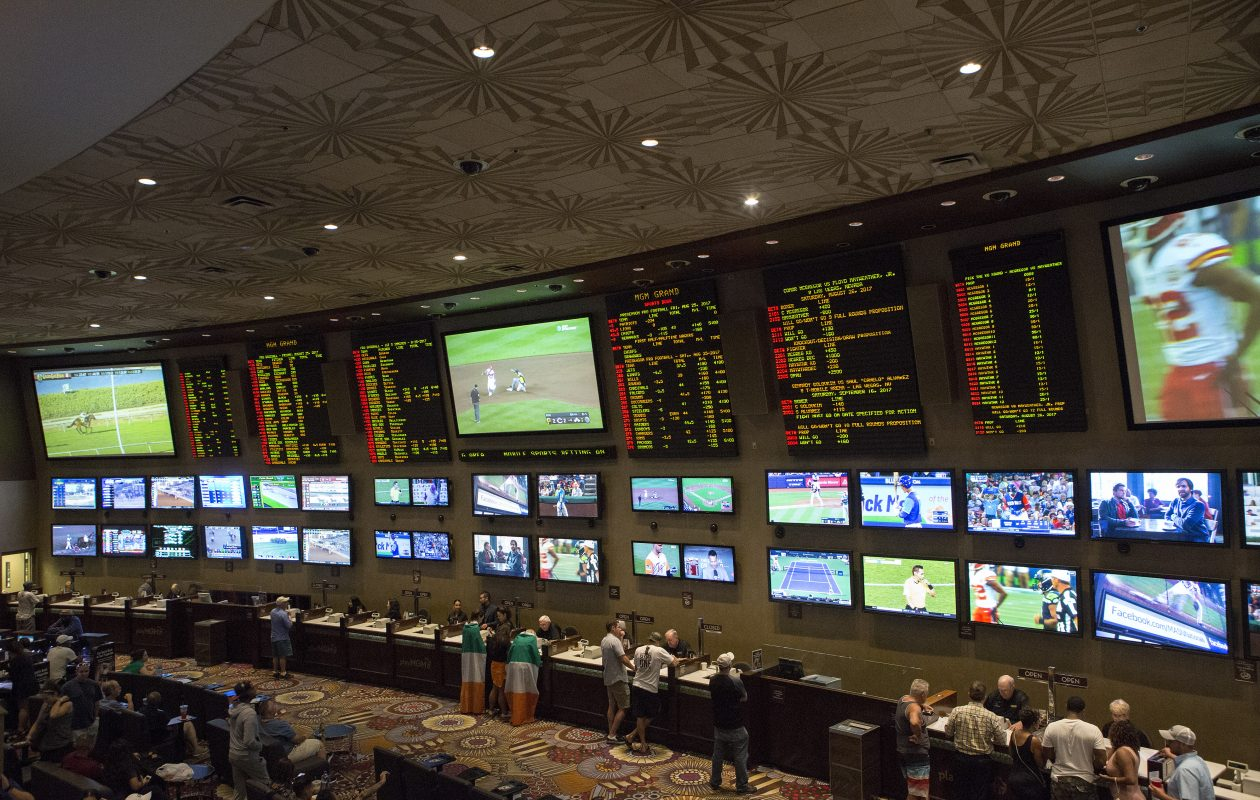 People place bets on sports at the MGM Grand Race & Sports Book in Las Vegas. Americans are estimated to annually place $150 billion in illegal wagers on sports. (Bridget Bennett/The New York Times)