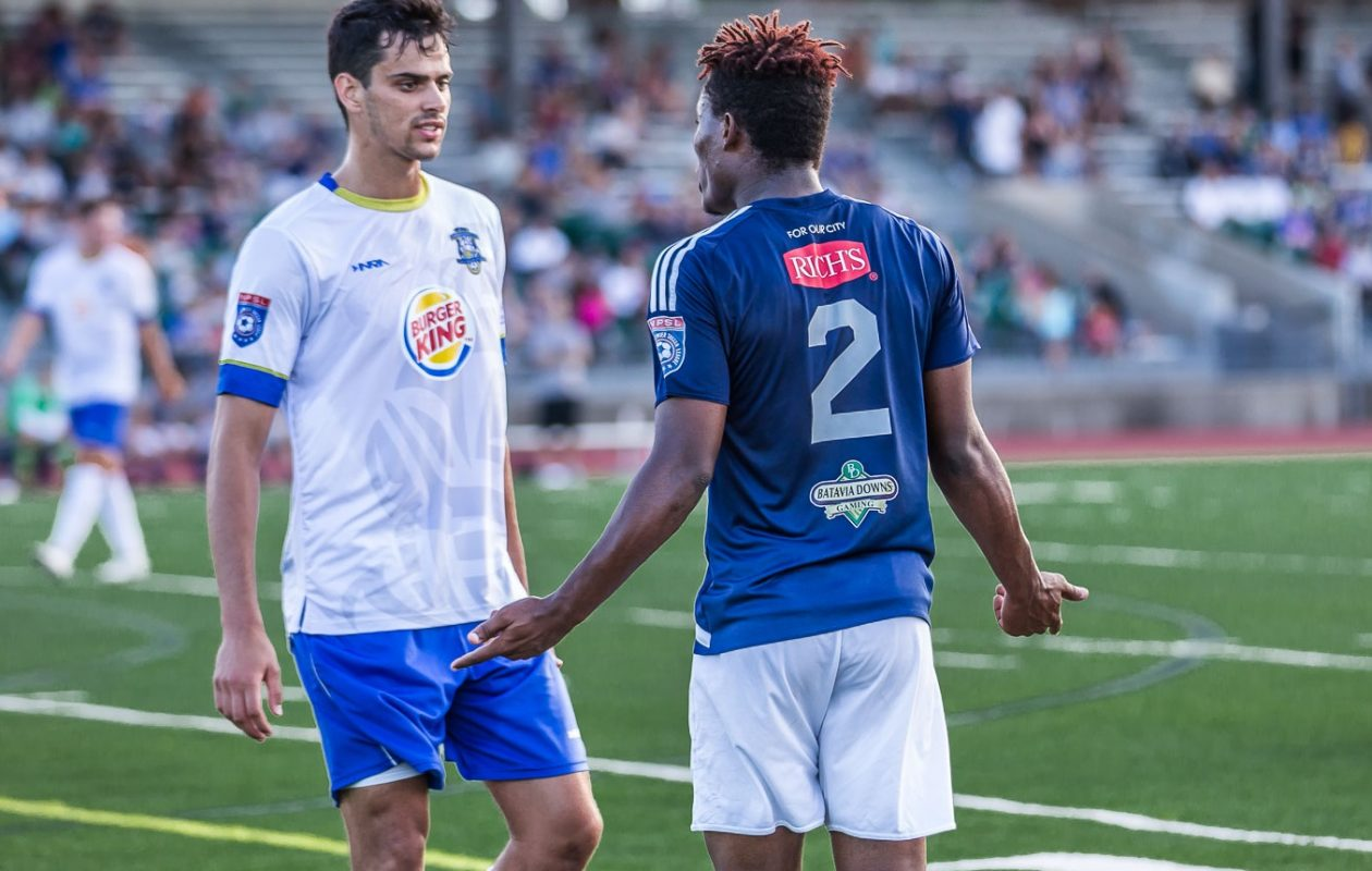 FC Buffalo, in blue, and the Erie Commodores are heated rivals. Here, Akean Shackleford argues a call with an Erie defender. (Don Nieman/Special to The News)