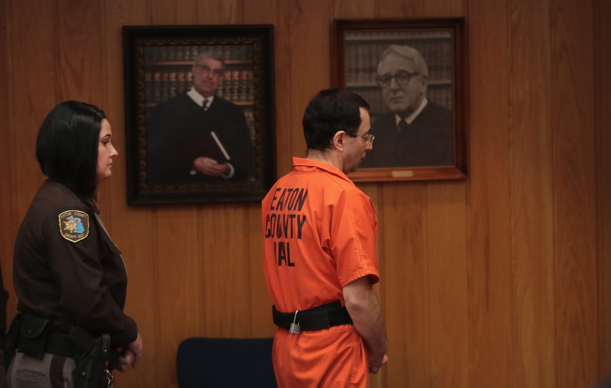 Larry Nassar is led from the courtroom after being sentenced by Judge Janice Cunningham to 40 to 125 years in prison for three counts of criminal sexual assault in February. Nassar has been accused of sexually assaulting more than 150 girls and young women while he was a physician for USA Gymnastics and Michigan State University.  (Getty Images)