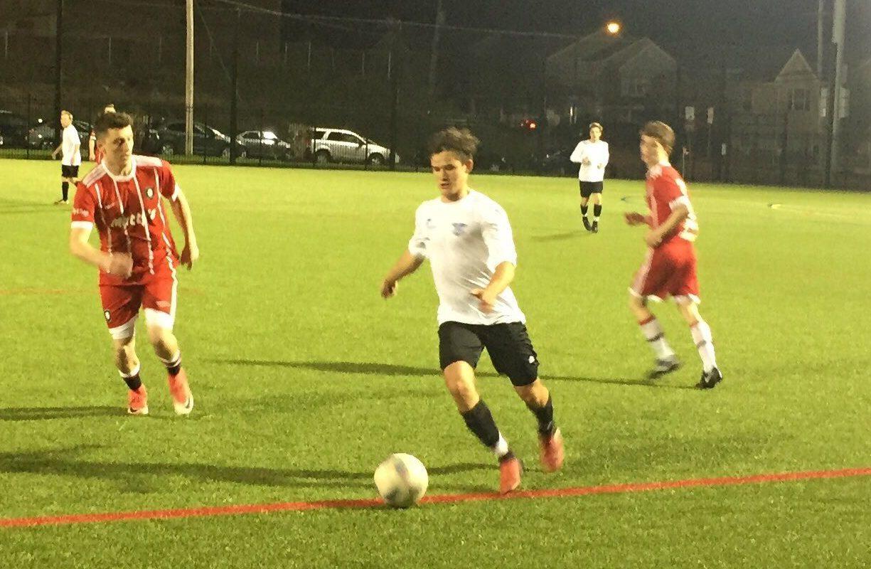 Southtowns midfielder Matt Burke, with the ball, scored the game's first goal. (Ben Tsujimoto/Buffalo News)
