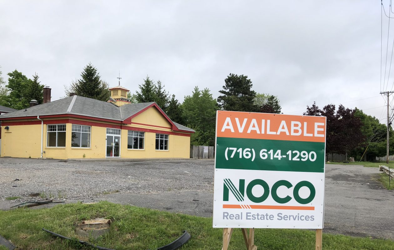 Noco Energy Corp. plans to build a car wash on the site of this former Getty gas station at 6164 Main St. in Amherst and two neighboring parcels. The project would require a rezoning for the adjoining parcels. (Stephen T. Watson/Buffalo News)