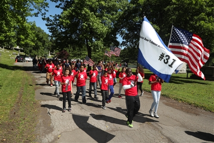 Veterans and students from Public School 17, 31 and 45 parade and celebrate Flag Day at Forest Lawn Cemetery on Thursday, June 14, 2018.