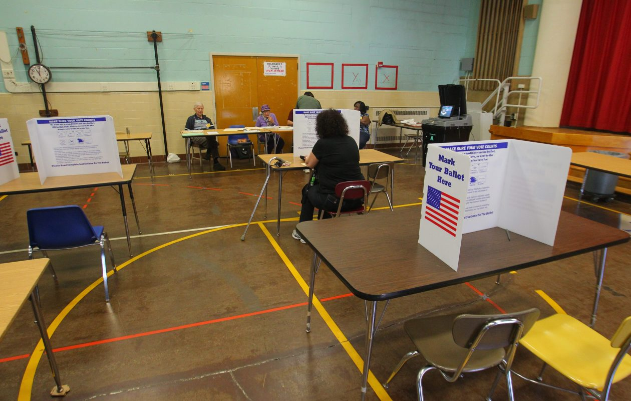 A near-empty voting room during a recent Buffalo School Board election illustrates why advocates want to move the balloting from May to November. But research indicates that change alone may not always draw enough extra voters to have an impact. (John Hickey/News file photo)