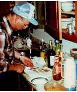Color Photograph MAN in CAP Cooks FISH Chef w W... - $5.06