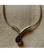 Garnet colored pear shape Crystal mounted on go... - $12.00