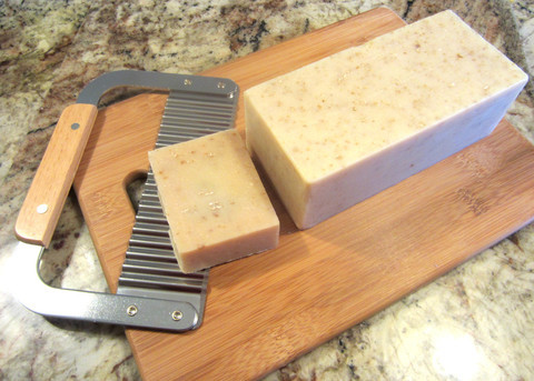 A Loaf of 'Mango Papaya' Soap with a Cutter & Cutting Board