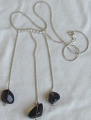 T Brown silver necklace