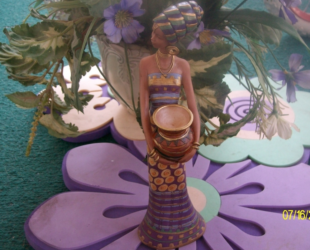 Kwanzza  Girl  Holding  Jar