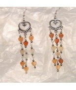 Amber, peach and clear hearts in silver earring... - $10.00