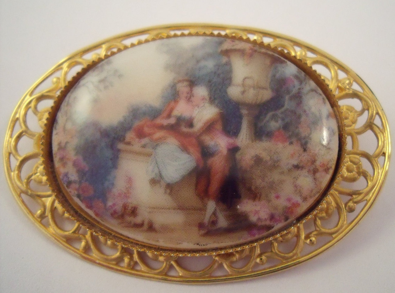 Filigree brooch with printed ceramic romantic scene