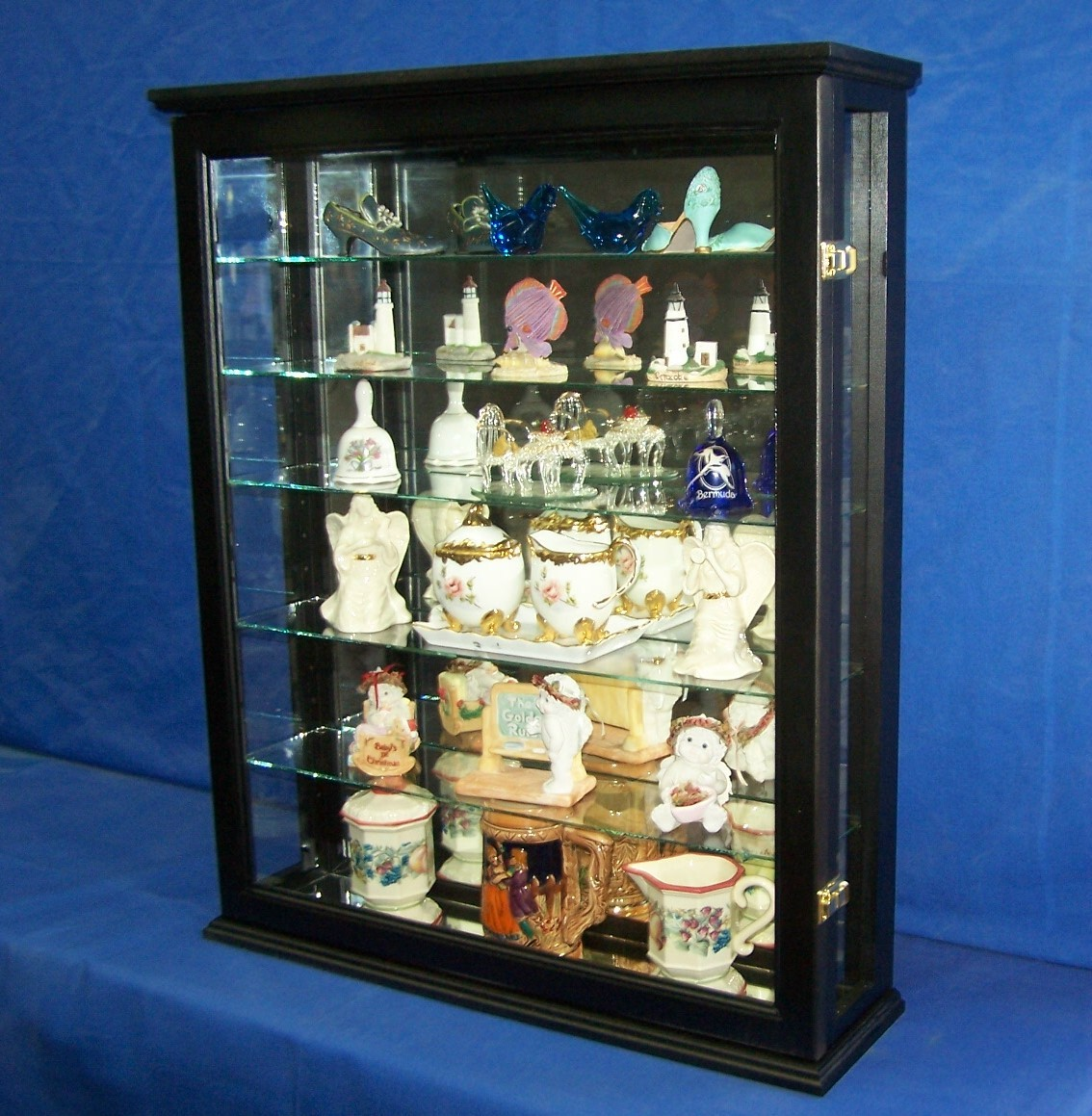wall mounted curio cabinet cabinets cupboards. Black Bedroom Furniture Sets. Home Design Ideas