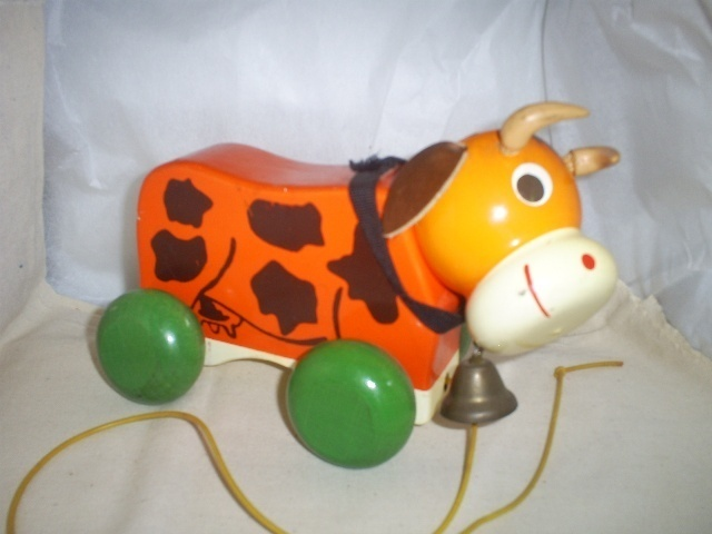 Vintage Wooden Cow Pull Toy on Wheels,Leather ears and original pull,Collectible
