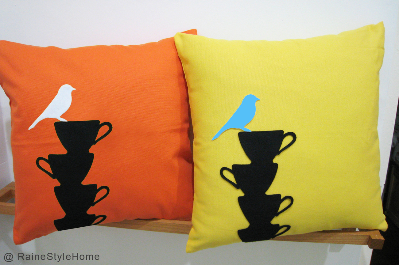 Bird_on_teacups_yellow_n_orange_blue_bird
