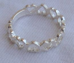 Open_hearts_silver_ring-2